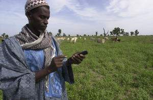 person with mobile phone in Africa